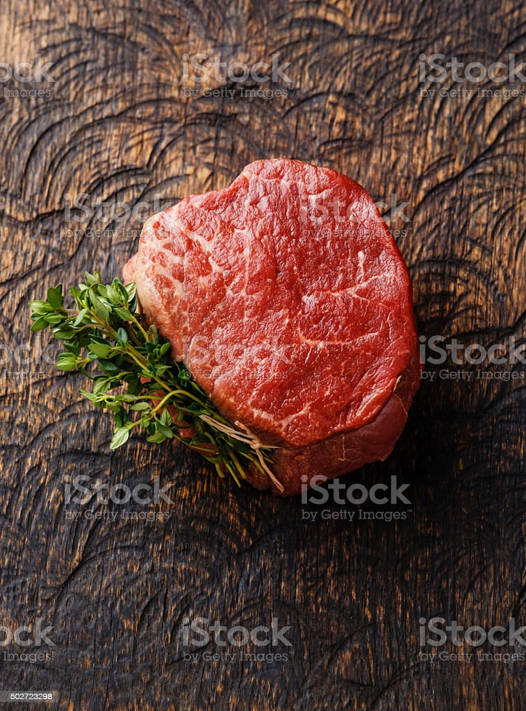 Raw meat Steak filet mignon and thyme stock photo
