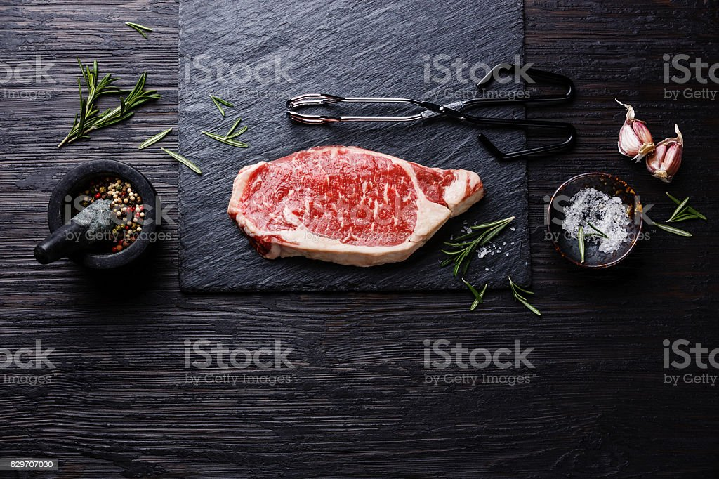 Raw meat Steak on wooden background copy space stock photo