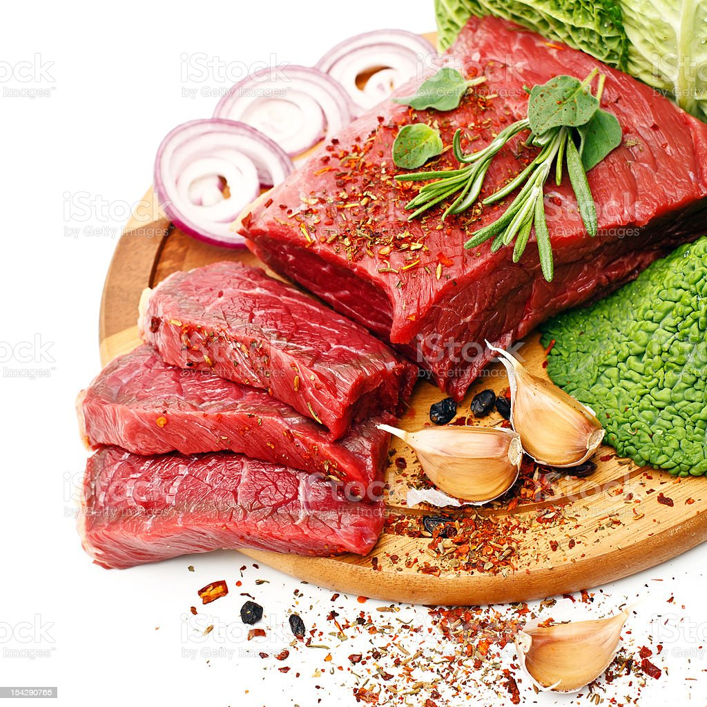 Raw meat with condiments royalty-free stock photo