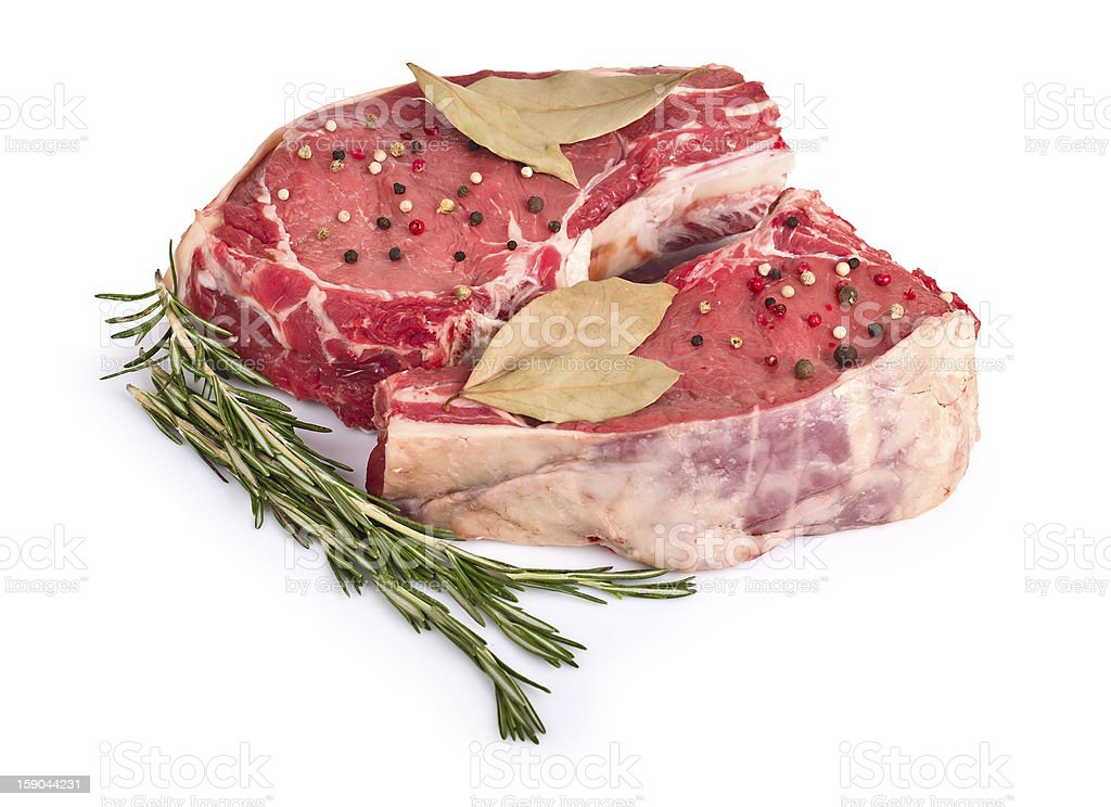 Raw meat with rosemary isolated royalty-free stock photo