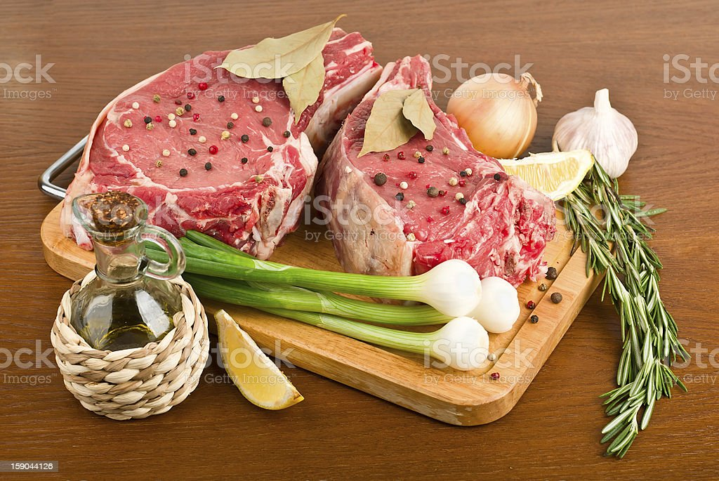 raw meat with rosemary royalty-free stock photo