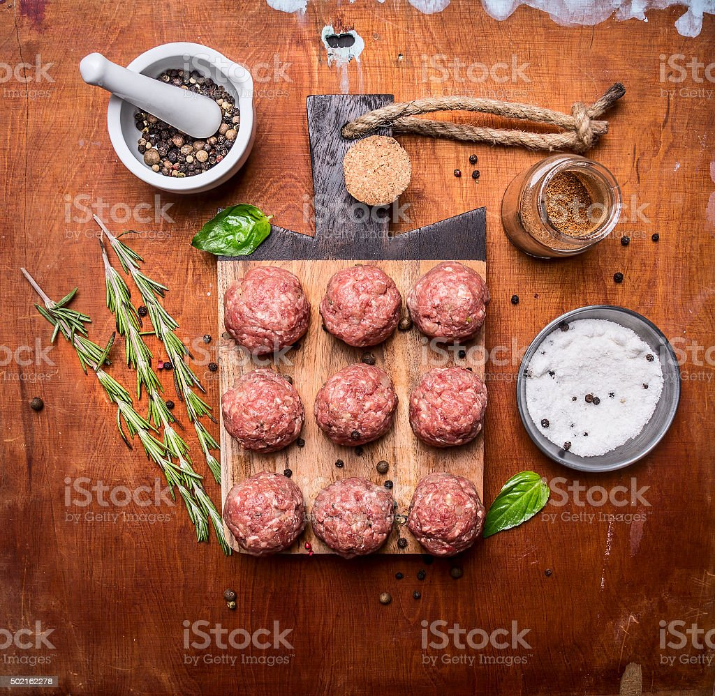 raw meatballs  herbs spices wooden rustic background top view stock photo