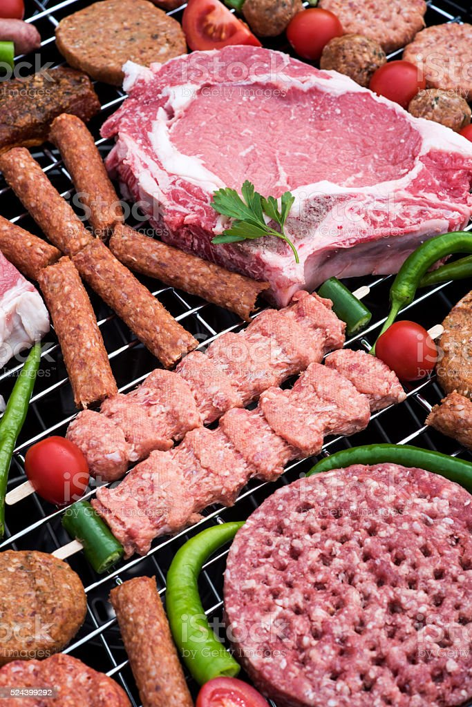 Raw meats on a barbecue stock photo