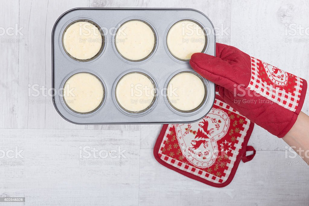 Raw muffins on wood background stock photo