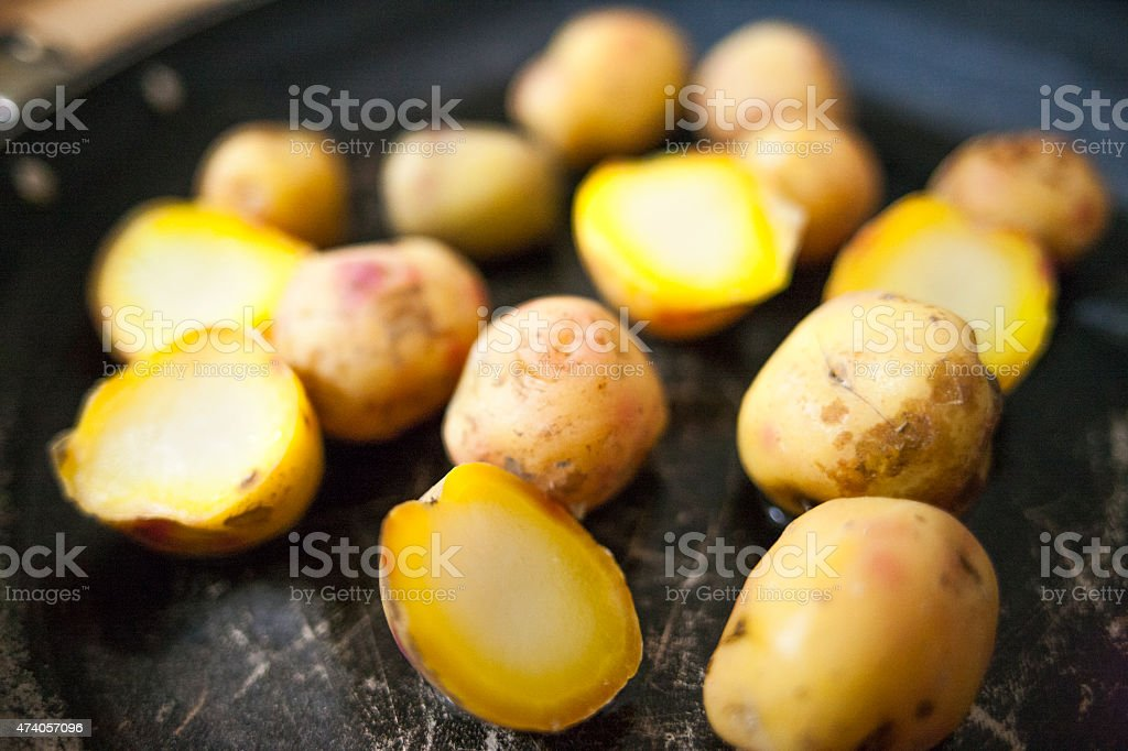 Raw multi-colored small potatoes stock photo