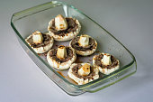 raw mushrooms in glass