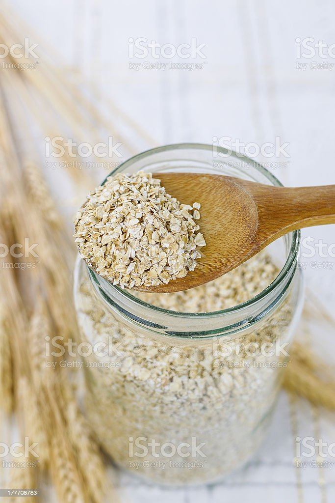 Raw Oats in Wooden Spoon royalty-free stock photo