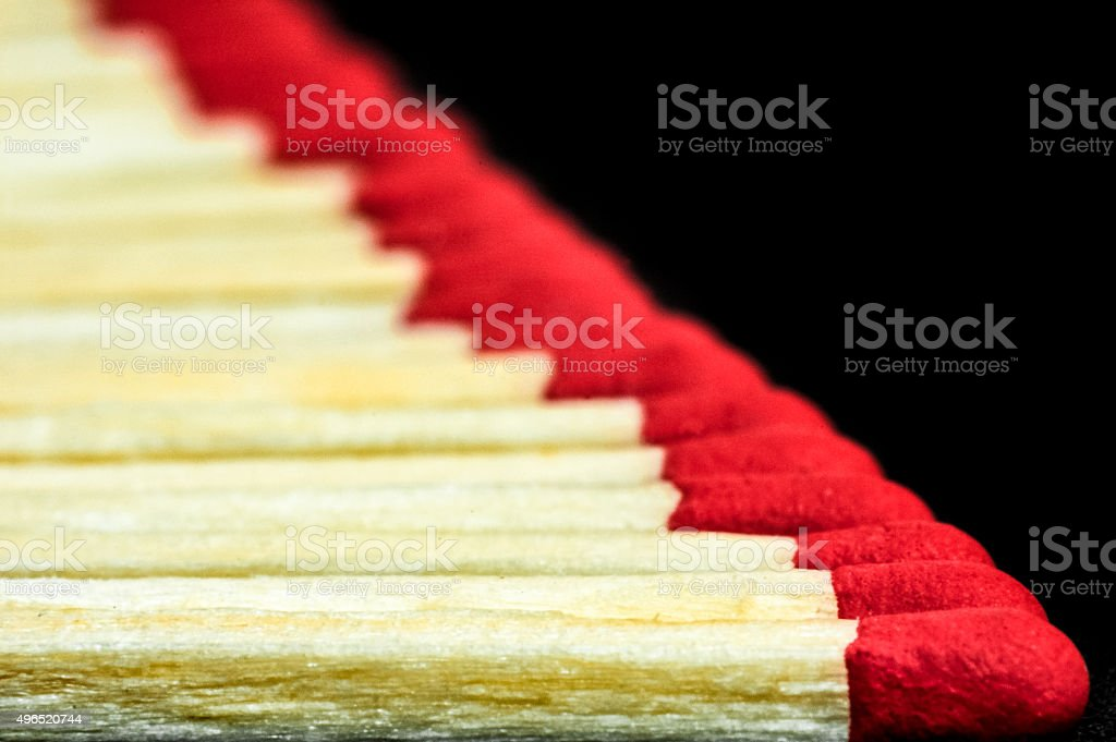 Raw of matches on black background stock photo