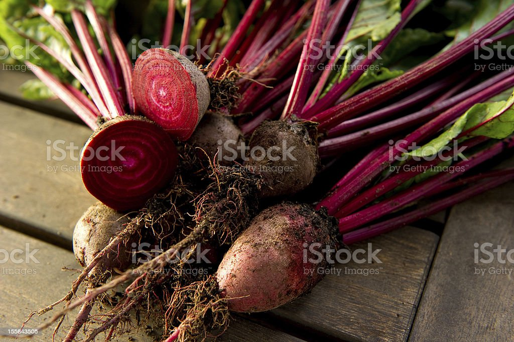 Raw organic beet roots both whole and halved royalty-free stock photo