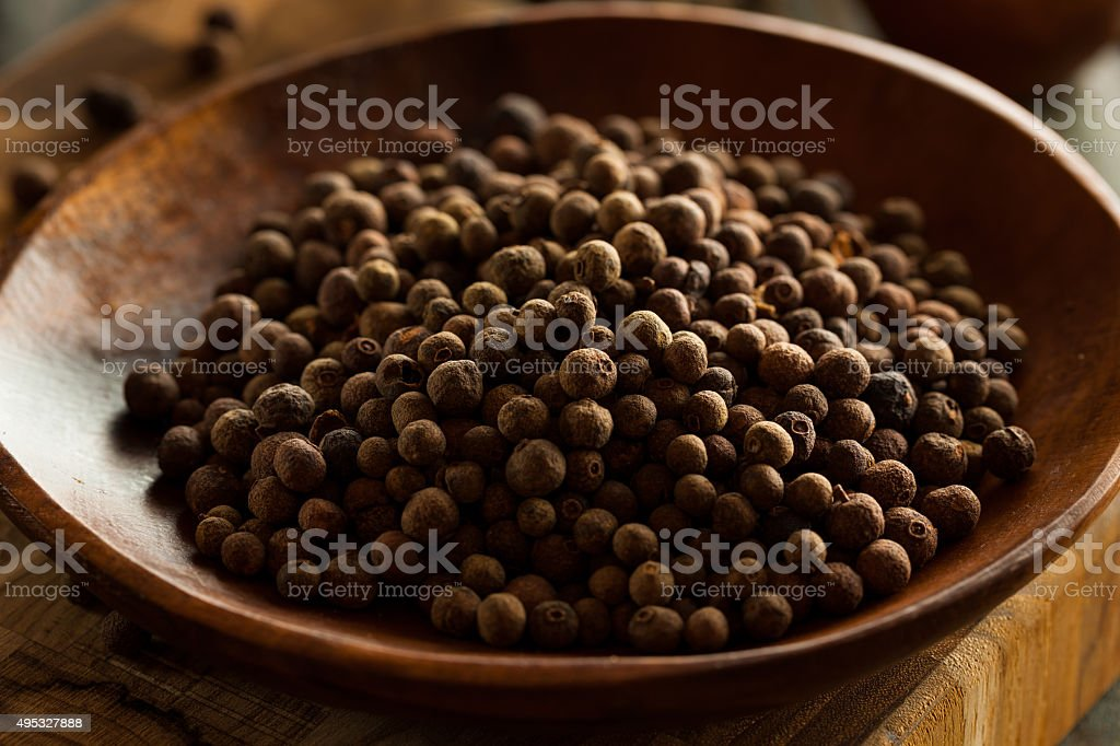 Raw Organic Brown Allspice stock photo