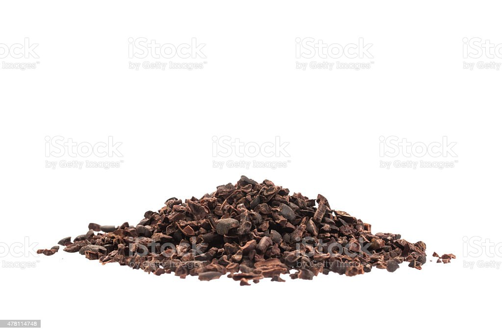 Raw organic cacao nibs isolated on white stock photo