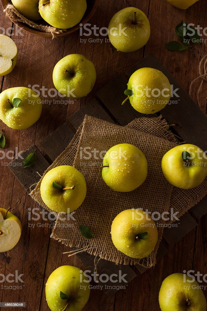 Raw Organic Golden Delicious Apples stock photo