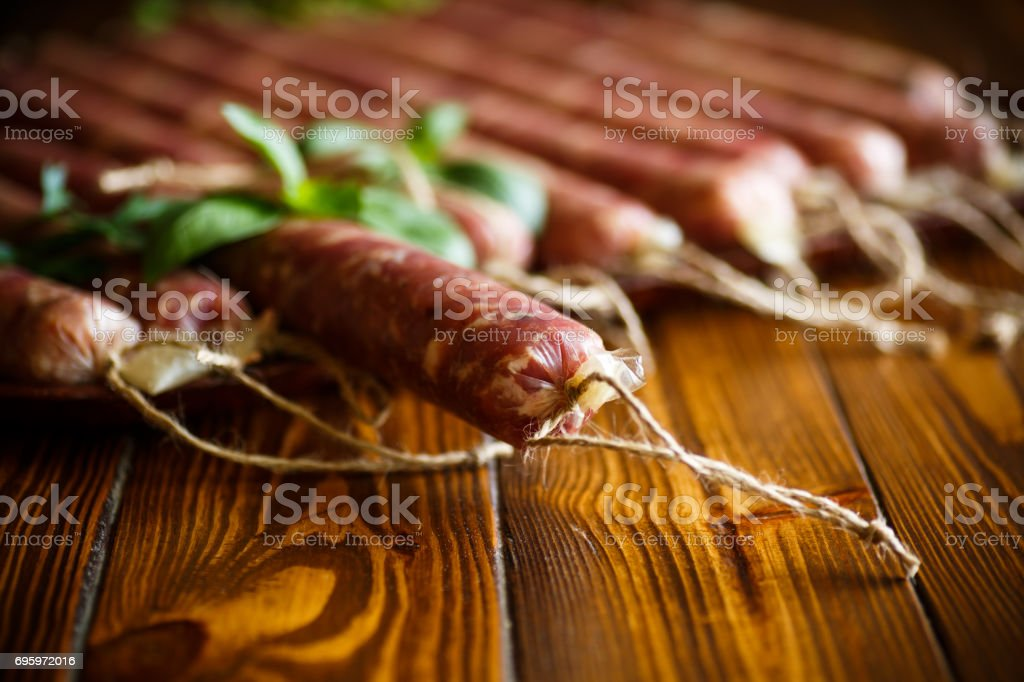 Raw organic homemade sausage made from natural meat stock photo