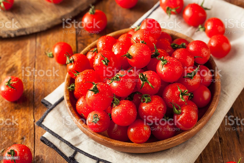 Raw Organic Red Cherry Tomatoes stock photo