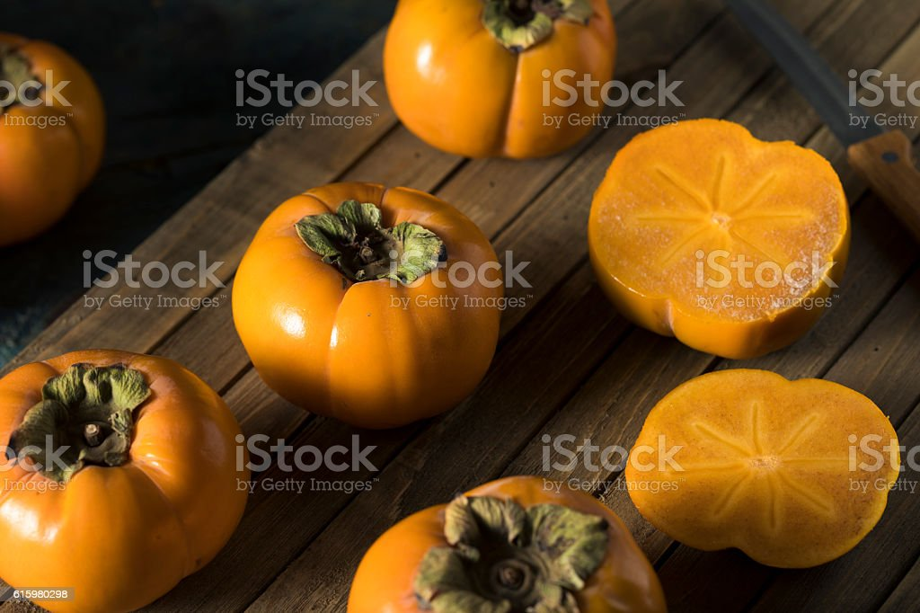 Raw Organic Yellow Persimmons stock photo