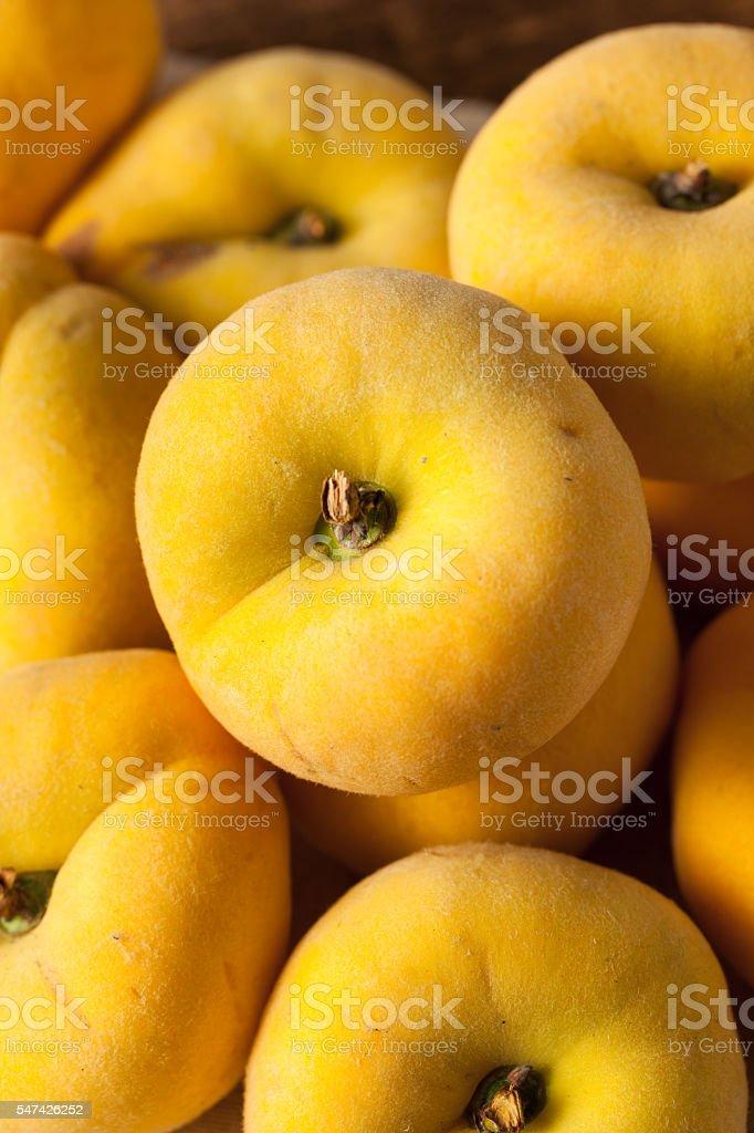 Raw Organic Yellow Pie Peaches stock photo