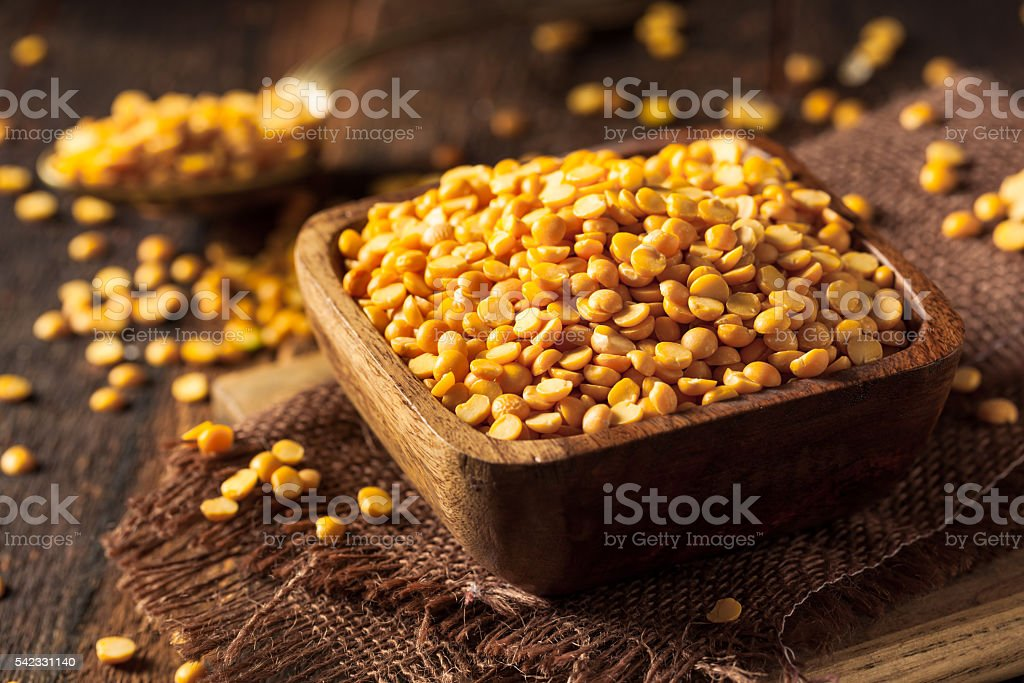 Raw Organic Yellow Split Peas stock photo