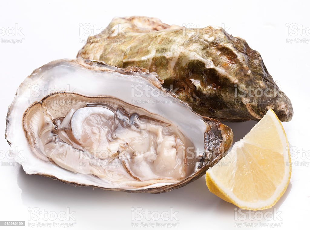 Raw oyster and lemon. stock photo