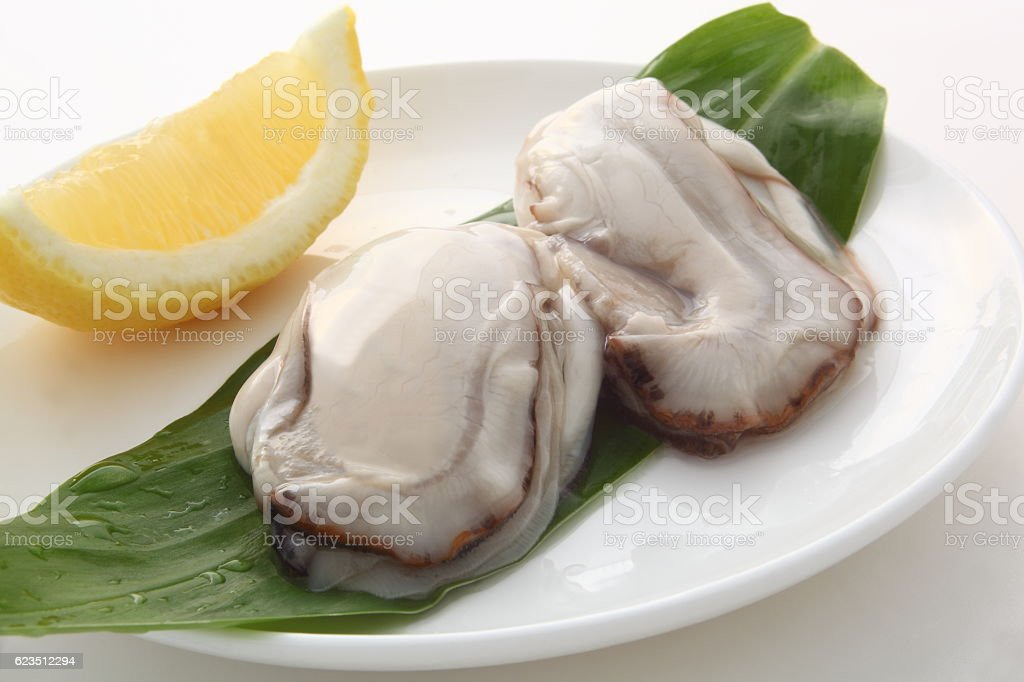 Raw oyster with lemon stock photo