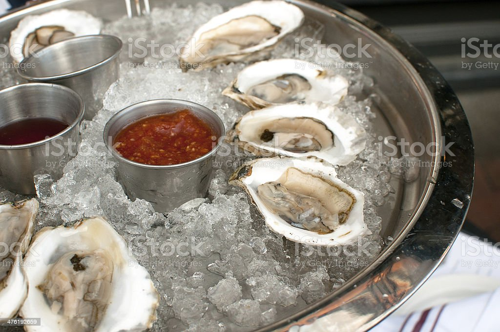 raw oysters with sauces royalty-free stock photo