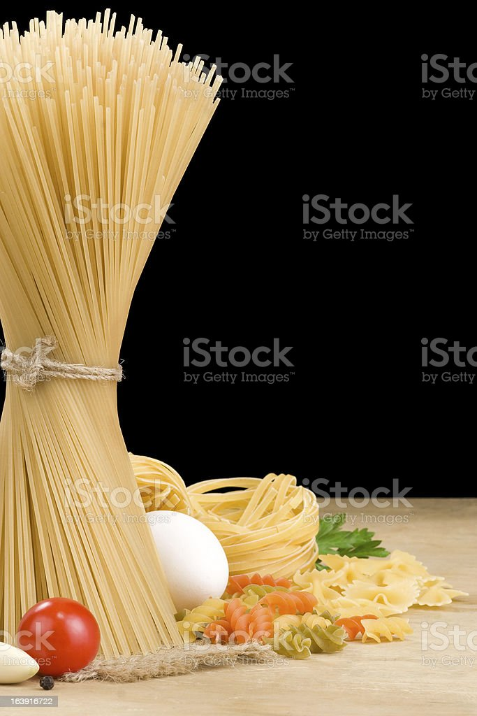 raw pasta and food vegetable isolated on black royalty-free stock photo
