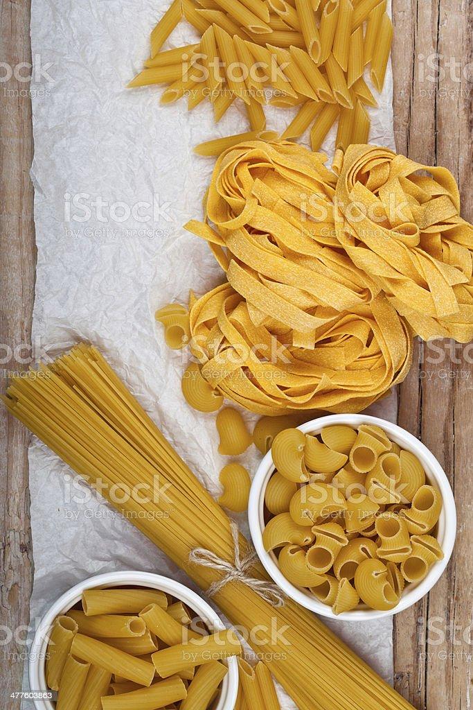 raw pasta and white paper stock photo