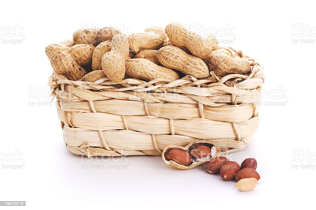 raw peanuts in basket royalty-free stock photo
