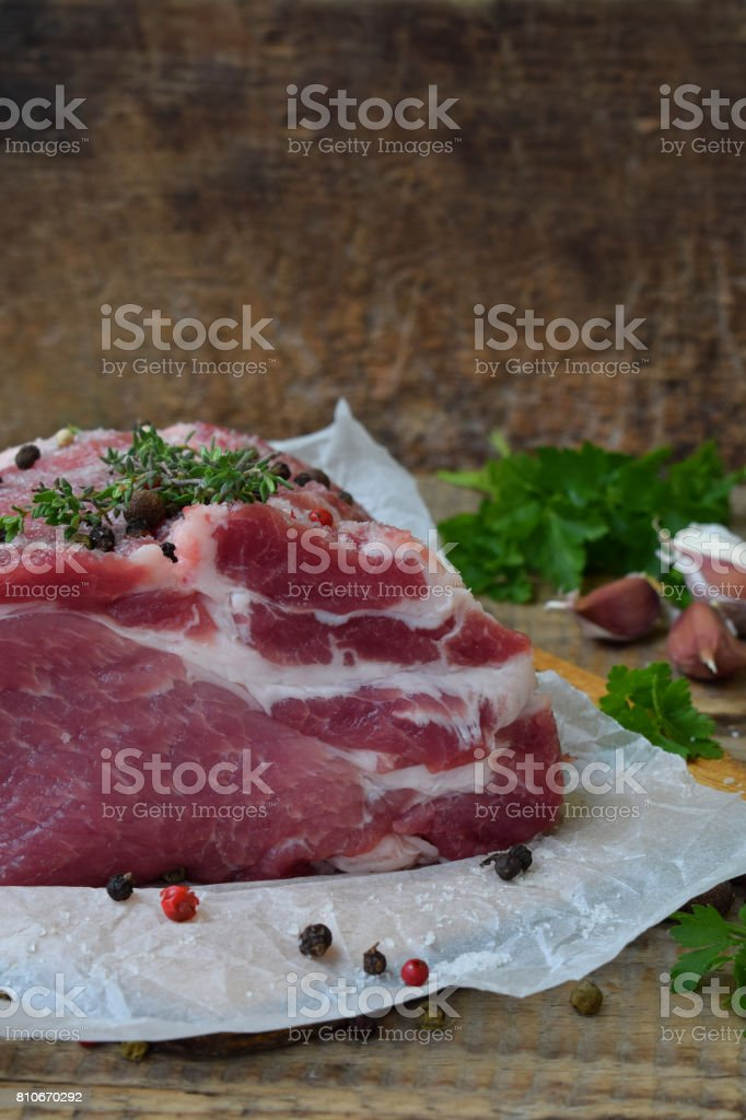 raw piece meat of pork and spices marinade on wooden background. For steak, roasting, stewing. Space for text stock photo