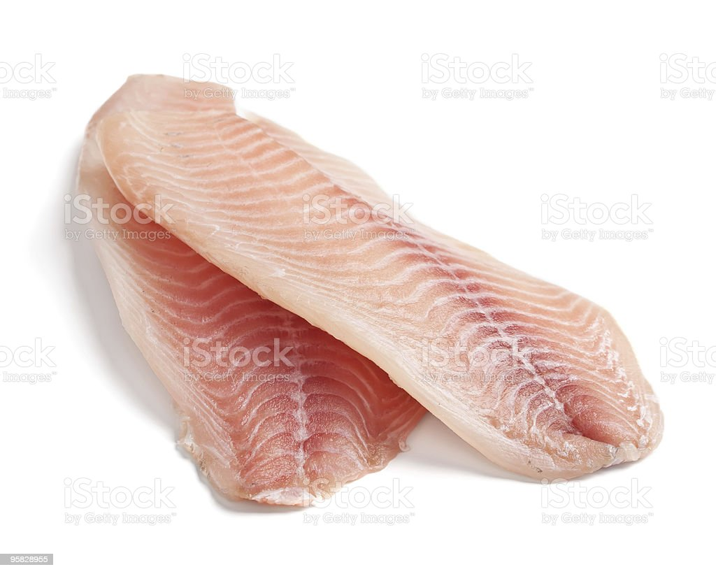 Raw pink filleted tilapia fish stock photo