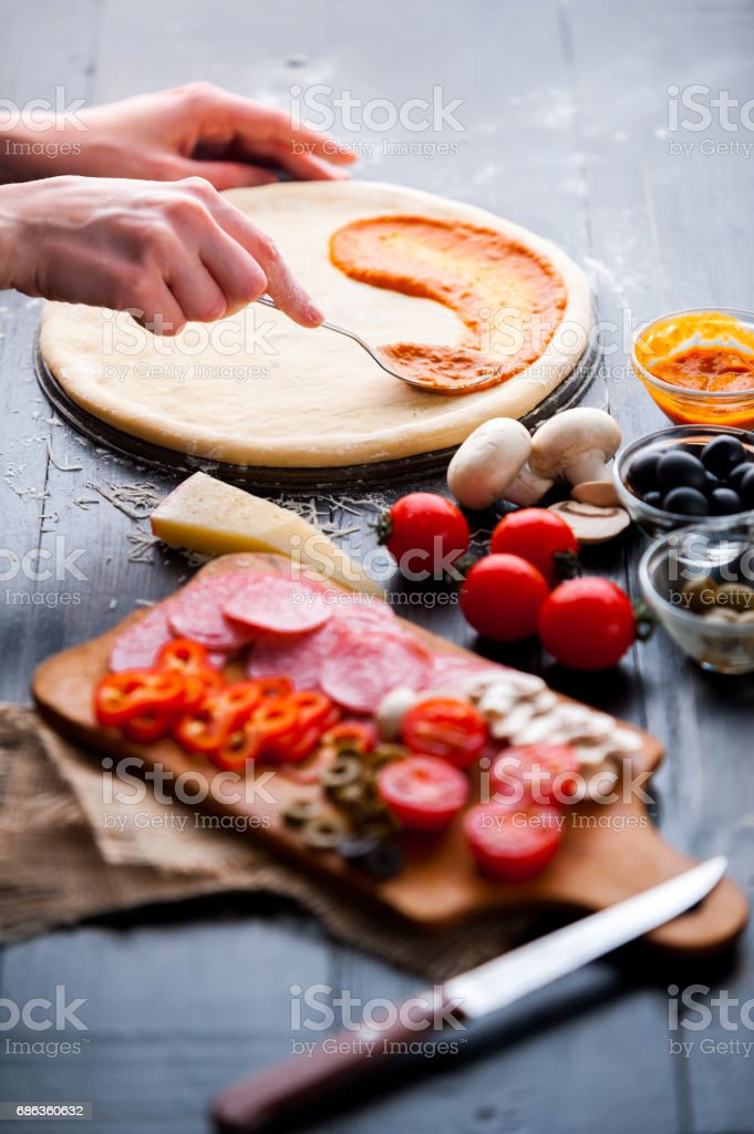 Raw pizza ingredients on wooden table stock photo