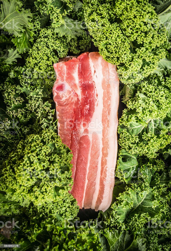 Raw Pork brisket  and kale, top view stock photo