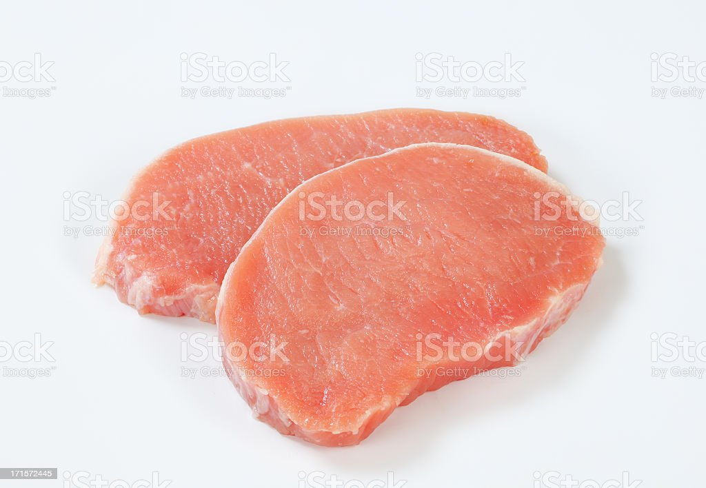 raw pork loin chops stock photo