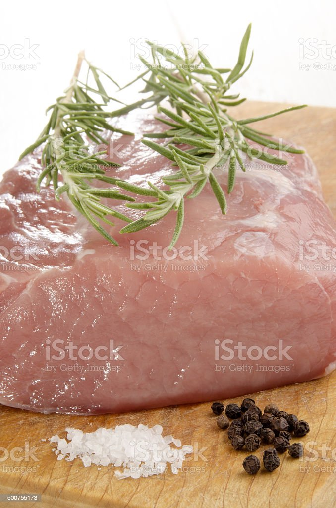 raw pork loin on a wooden board royalty-free stock photo