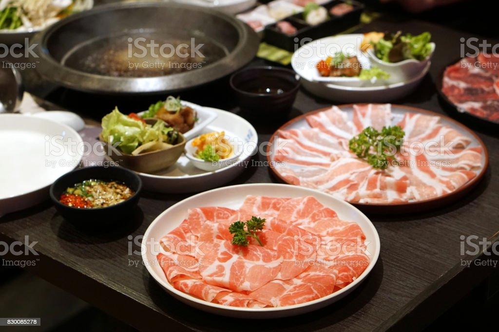 Raw pork sliced for Japanese hot pot also known as Shabu Shabu or Sukiyaki is Japanese. stock photo