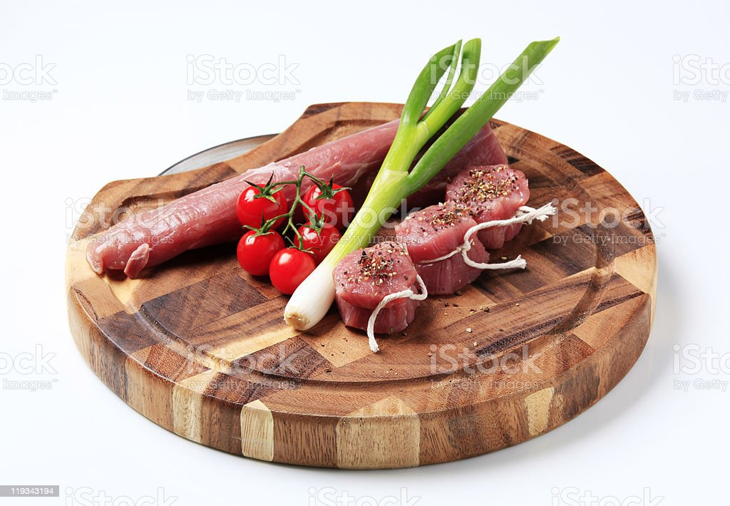 Raw pork tenderloin and vegetables royalty-free stock photo