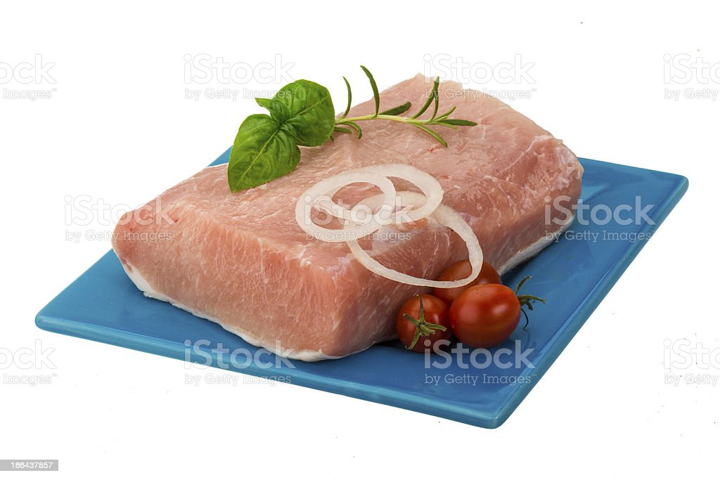 Raw pork with onion, basil and rosemary royalty-free stock photo