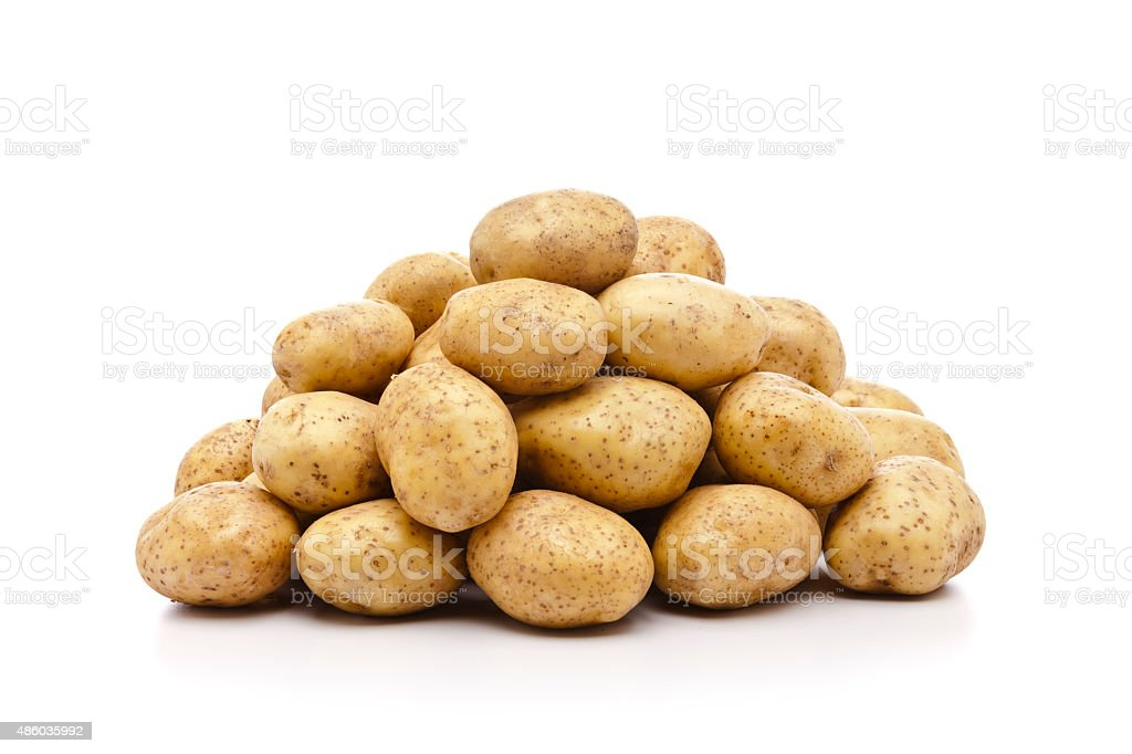 Raw potato pile isolated on white background stock photo