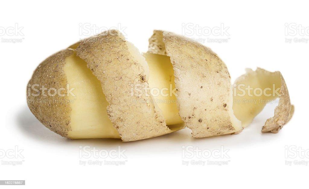 Raw potato with cutting peel stock photo