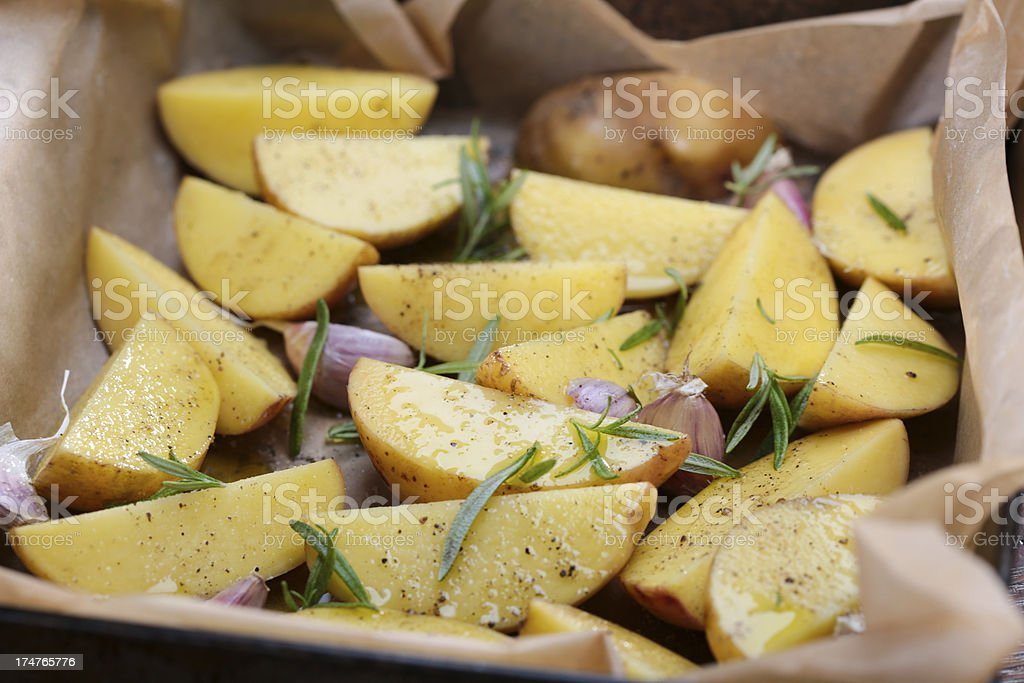 Raw potato with garlic royalty-free stock photo