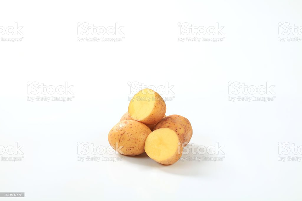 Raw potatoes cut in halves stock photo