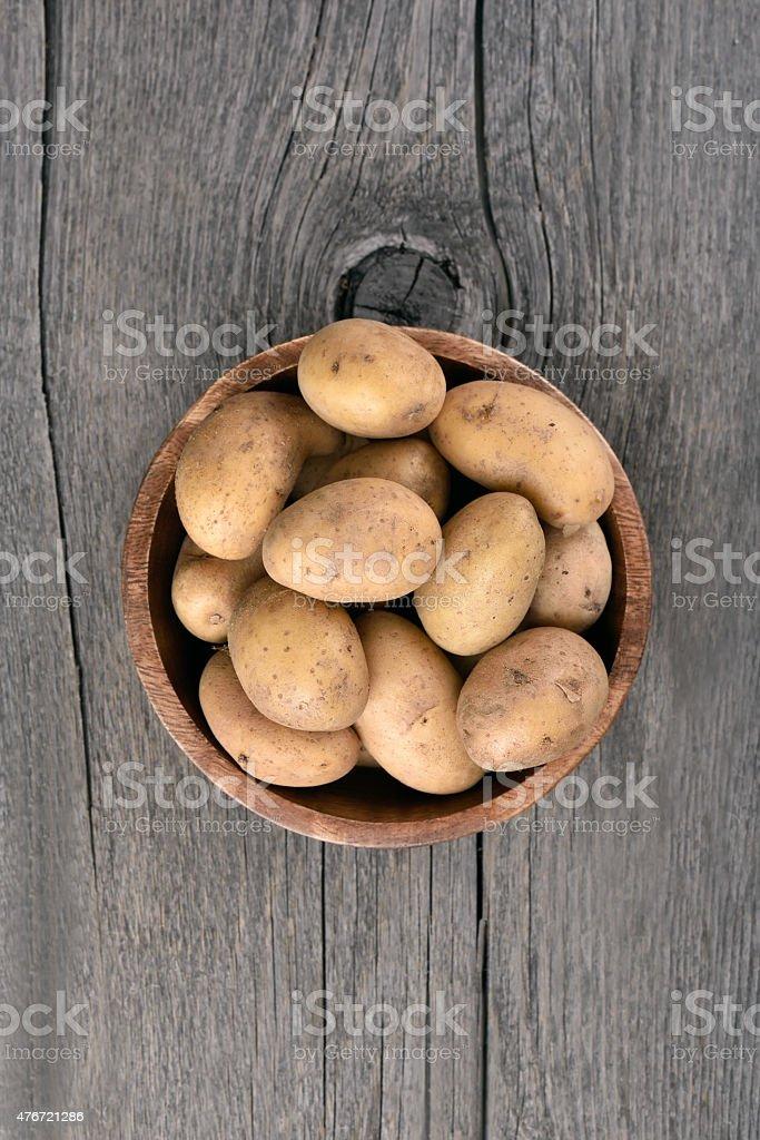 Raw potatoes in bowl stock photo