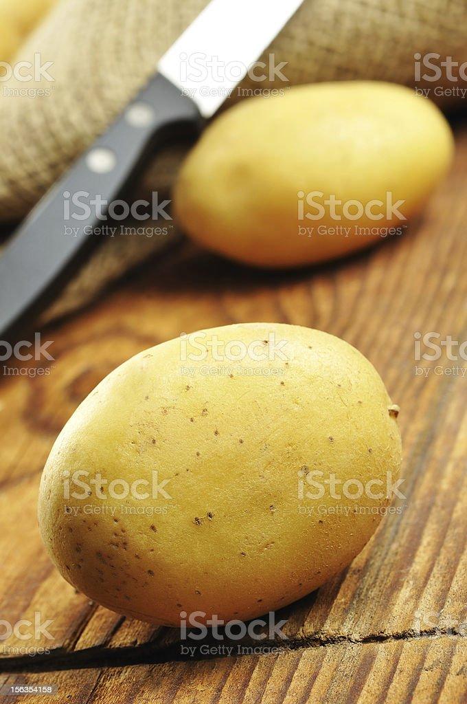 Raw potatoes in jute sack, selective focus royalty-free stock photo