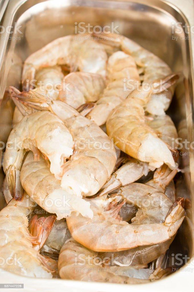 Raw Prawns in a Kitchen Tray stock photo
