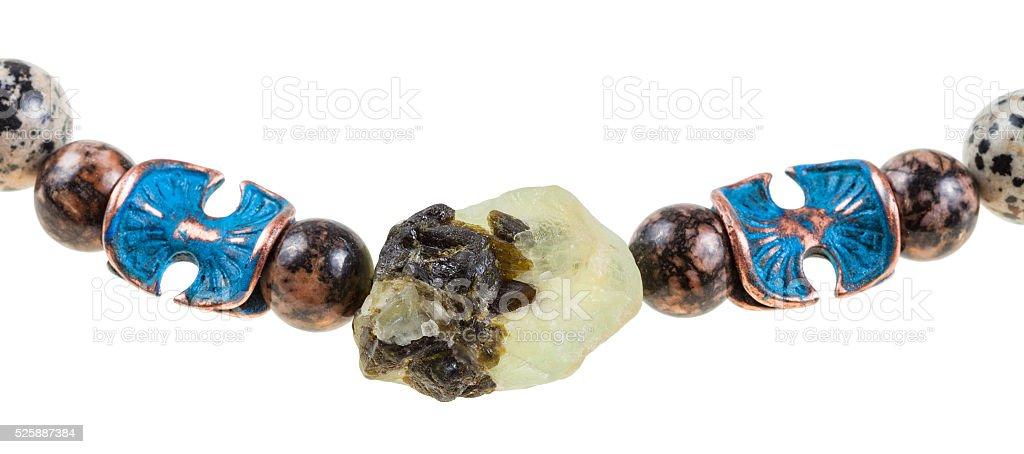 raw Prehnite stone and rhodonite ball in necklace stock photo