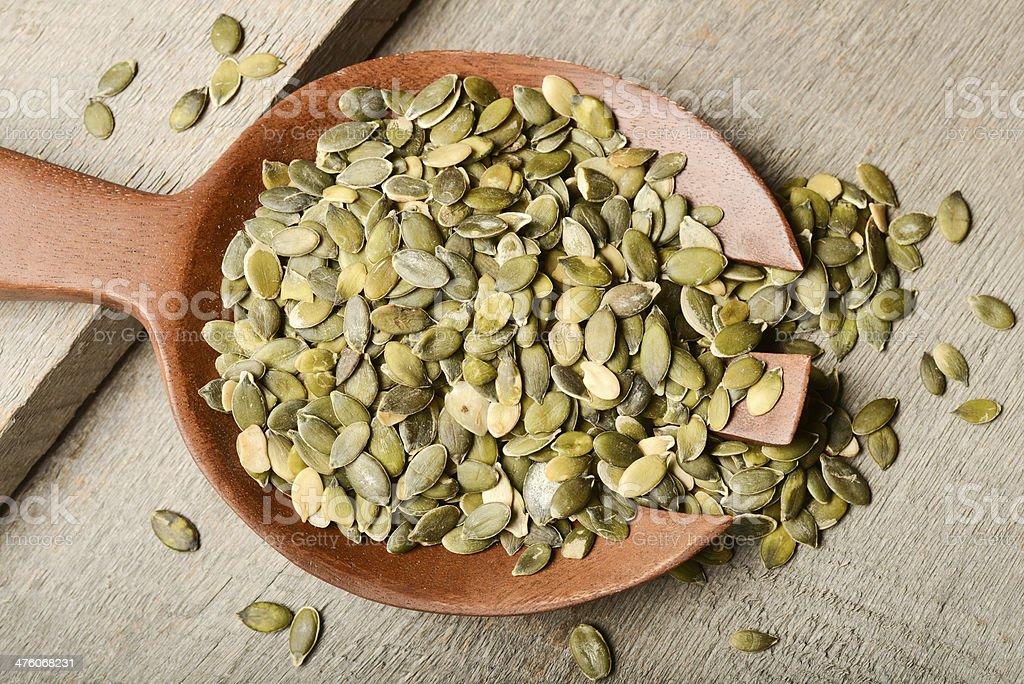 Raw pumpkin seeds royalty-free stock photo