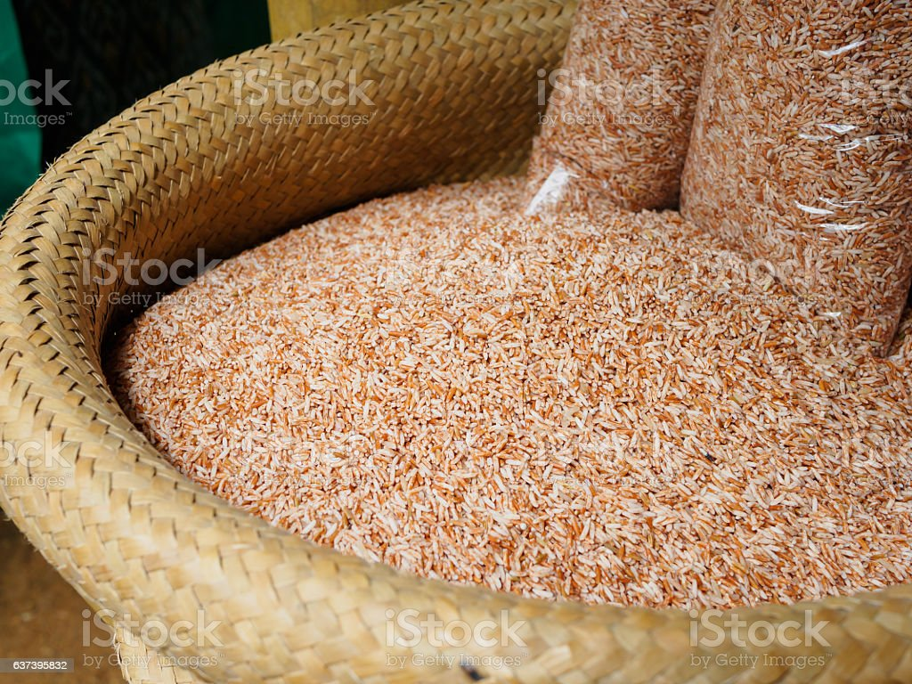 Raw Purple Riceberry rice or brown rice in bamboo weave basket stock photo