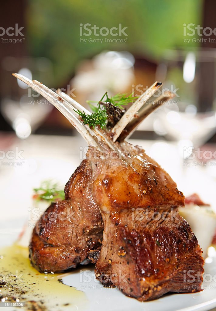 Raw rack of lamb fried with herbs and spices stock photo