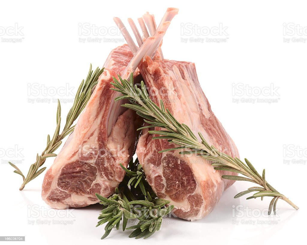 Raw rack of lamb with rosemary, isolated on white stock photo