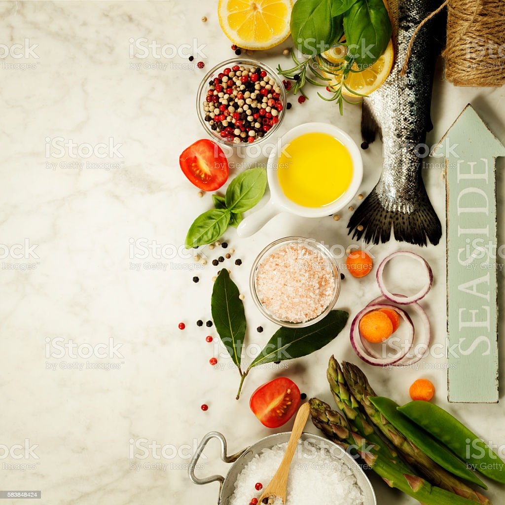 Raw rainbow trout with vegetables, herbs and spices stock photo