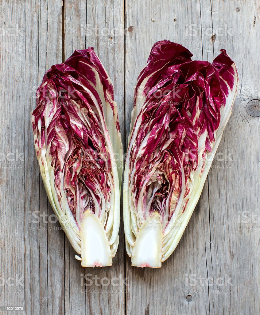 Raw red chicory on a wooden table stock photo